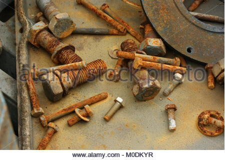 Nuts and Bolts in scrap yard - Stock Photo