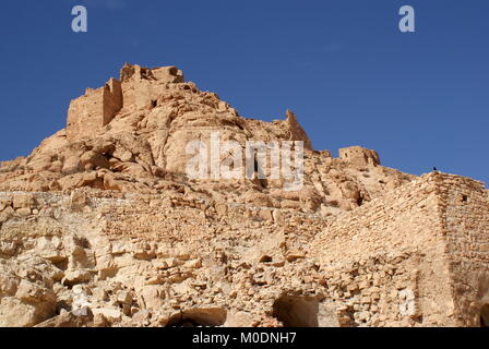 View of the abandoned hilltop Berber village and citadel of Douiret, Douiret, Tataouine district, Tunisia - Stock Photo