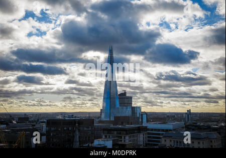 Commercial property and real estate skyline: rooftop view of the Shard, London's tallest building, with gathering - Stock Photo