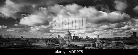 Panoramic rooftop view over London towards the landmark iconic dome of Sir Christopher Wren's St Paul's Cathedral - Stock Photo