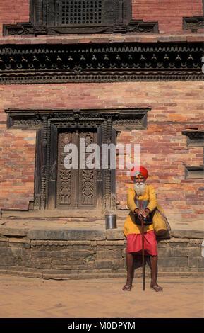 Nepal. Kathmandu, Bhaktapur. Sadhu (holy man) in front of temple (Hindu). - Stock Photo