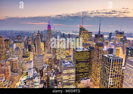 New York City, USA midtown Manhattan financial district cityscape at dusk. - Stock Photo