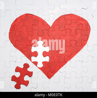 puzzle heart need one piece - Stock Photo