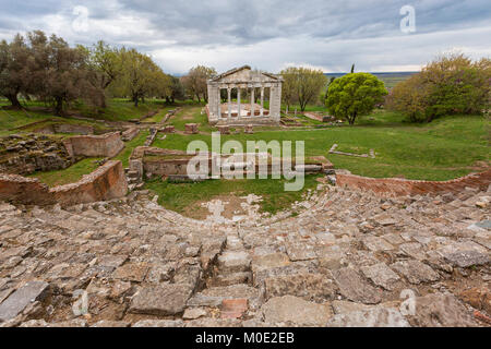 Remains of Roman temple with theatre seats in the foreground, in the ancient site of Apollonia in Albania. - Stock Photo