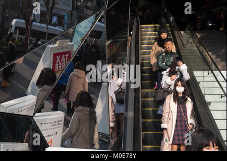 31.12.2017, Tokyo, Japan, Asia - People are reflected in the mirrored entrance of the Tokyu Plaza Omotesando shopping - Stock Photo