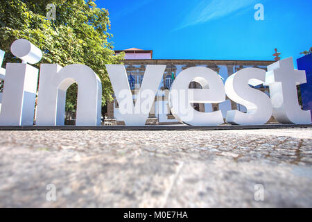 Word Invest created by big plastic letter - Stock Photo