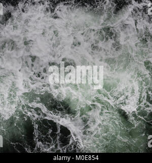 Big water splash seen from above a boat - Stock Photo