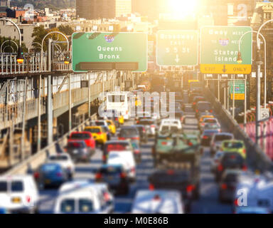 Rush hour traffic jam of cars, buses, taxis and trucks on the Williamsburg Bridge in Brooklyn, New York City with - Stock Photo