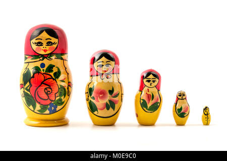 Matryoshka doll (little matron) on a white background - Stock Photo