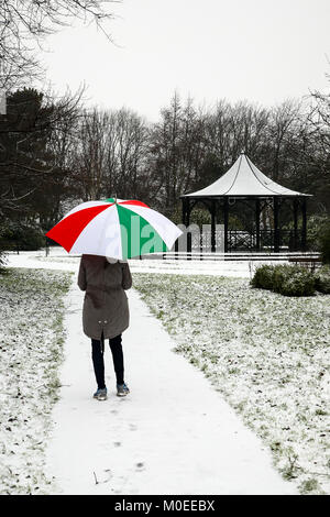 Leeds, UK. 21st Jan, 2018. A woman walks in Dartmouth Park, Morley this afternoon after snowfall in Leeds.Taken - Stock Photo