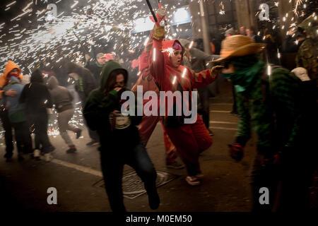 Barcelona, Catalonia, Spain. 21st Jan, 2018. In Barcelona a devil runs amidst the pyrotechnics during a correfoc - Stock Photo