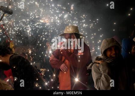 Barcelona, Spain. 21st Jan, 2018. In Barcelona revelers enjoy amidst the pyrotechnics during a correfoc (runfire) - Stock Photo