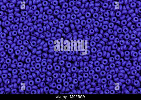 Many blue glass beads, background.