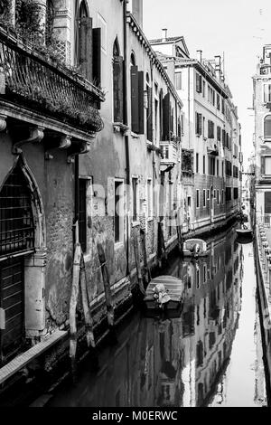 Narrow, ancient and romantic venetian canals. Venice, Italy. Black and white image. - Stock Photo