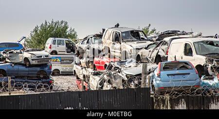 Scrap cars in breaker's yard, Flint, Flintshire, Wales, UK - Stock Photo
