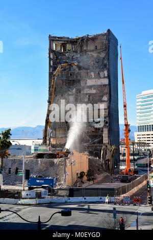 Demolition crew tearing down an old hotel in downtown Las Vegas - Stock Photo