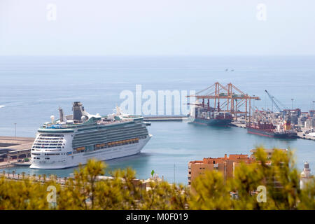 Royal Caribbean Navigator of the seas cruise ship berthed in Malaga Spain alongside two bulk carrier ships in summer - Stock Photo