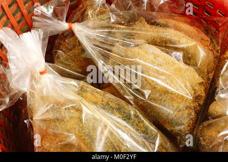 Local thai pickled fish or Pla-ra in the bag - Stock Photo