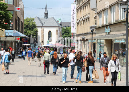 ESSEN, GERMANY - JULY 17: People shop downtown on July 17, 2012 in Essen, Germany. Essen is a city of almost 600 - Stock Photo