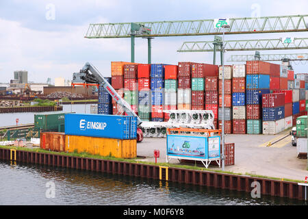 DORTMUND, GERMANY - JULY 16: Containers are loaded in Dortmund Port on July 16, 2012 in Germany. It is the largest - Stock Photo