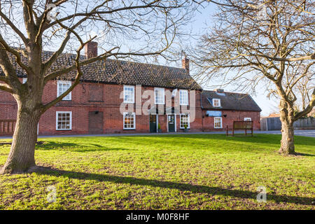 The village green, Orford, with the Jolly Sailor pub, UK Suffolk - Stock Photo