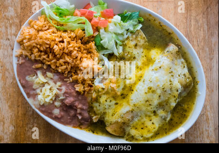 Enchiladas Suizas at Lupe's, a Mexican dish with chicken and sour cream - Stock Photo