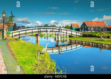The best famous touristic village Zaanse Schans with colorful houses and old traditional windmills on the water - Stock Photo