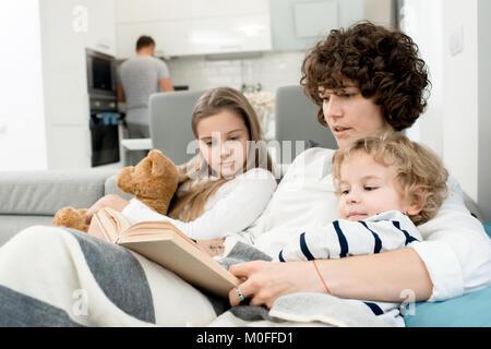 Loving Family Enjoying Weekend Together - Stock Photo