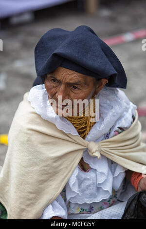 Otavalo, Ecuador - December 30, 2017: indigenous quechua woman at the Saturday market - Stock Photo