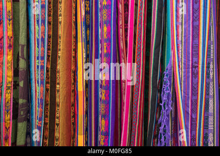 Otavalo, Ecuador - January 13, 2018: colourful indigenous textiles in the popular artisan market - Stock Photo