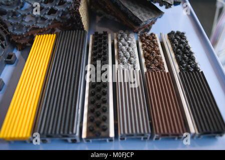 Closeup on board in hardware in auto manufacture - Stock Photo