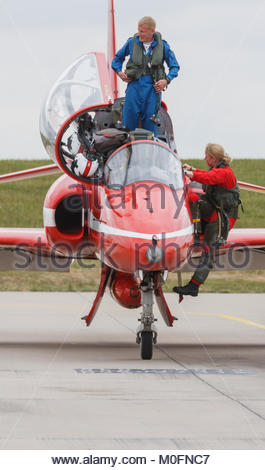 RAF Red Arrows Display team, Flt Lt Kirsty Moore Red Arrows first female pilot, climbing into her Hawk T1 jet. - Stock Photo