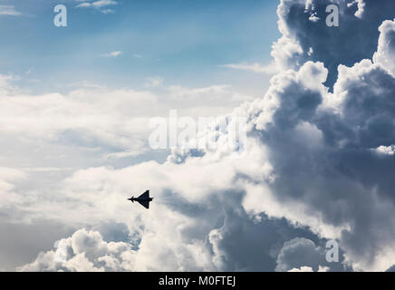 Eurofighter Typhoon jet fighter aircraft silhouetted against a cloudy sky with heat haze on 9th September 2017, - Stock Photo