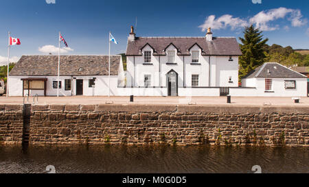 Fort William, Scotland, UK - May 24, 2010: Sun shines on the Lock-Keeper's Cottages at Corpach Basin on the Caledonian - Stock Photo