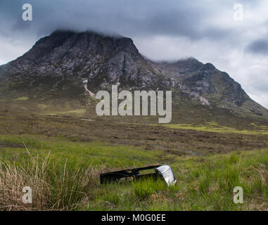 The distinctive mountain of Buachaille Etive Mor stands sentinal at the head of Glen Coe on the vast peat bog wilderness - Stock Photo