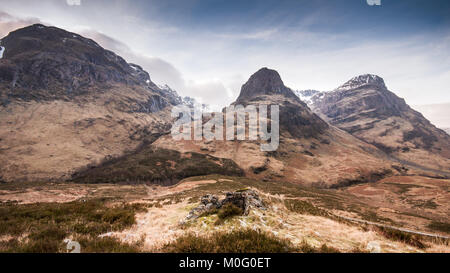The distinctive mountains of Aonach Dubh, Beinn Fhada and Gearr Aonach, collectively known as the Three Sisters - Stock Photo