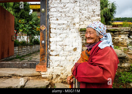Thimphu, Bhutan - Aug 30, 2015. Portrait of old woman at monastery in Thimphu, Bhutan. It is believed that Buddhism - Stock Photo