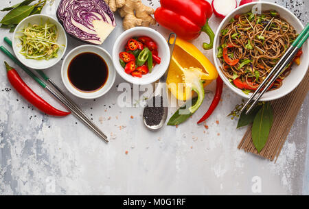 Healthy vegan buckwheat noodles with a mix of vegetables, sprouts and nut-soy sauce. Vegetarian padthai soba noodles - Stock Photo