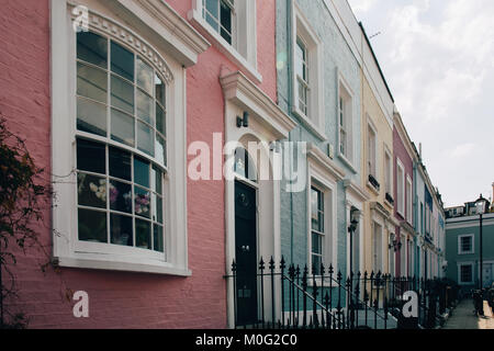 Colourful terraced houses of Notting Hill. Notting Hill is one of the most expensive residential areas in London, - Stock Photo