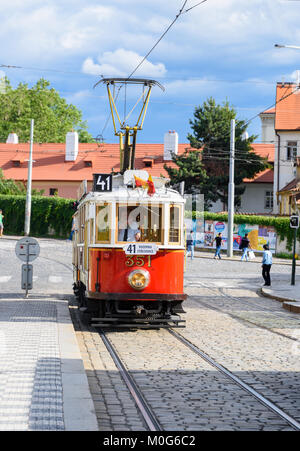 Prague, Czech Republic - July1, 2017: Historical Prague museum tram line 41 and an old tram driver on a cobble stone - Stock Photo