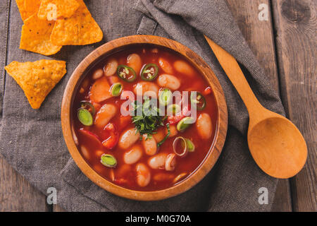 fried chicken half with potatoes and tomatoes in the frying pan - Stock Photo