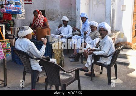 Local Rajasthanis enjoying chai, India's national beverage, Pushkar, Rajasthan, India - Stock Photo