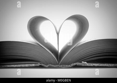 Book pages in the shape of a heart, black and white photography - Stock Photo