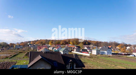 beautiful view from Windows on the houses and field, the village view from the window - Stock Photo