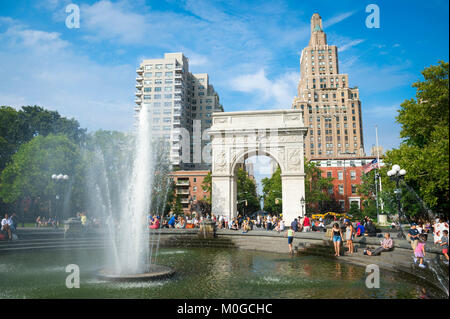 Scenic sunny summer afternoon view of the fountain and arch at Washington Square Park in Greenwich Village, downtown Manhattan, New York City