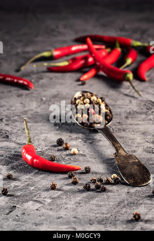 Red hot chilli pepper paprika in and peppers seed ball on stone table Ingredient for Mexican cooking, Trendy toned - Stock Photo