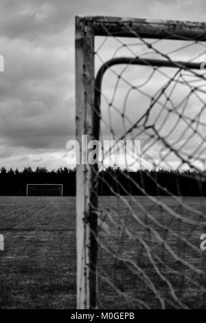 An empty football pitch with goals. (B/W) - Stock Photo