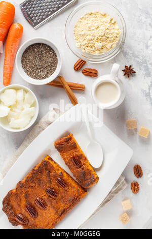 Healthy alternative vegan carrot cake, vegetarian pastries ingredients: chia, coconut butter, almond milk, nuts. - Stock Photo
