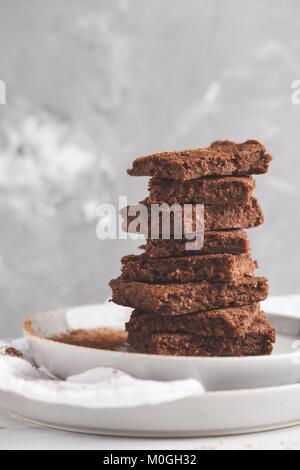 stack of slices of healthy vegan brownies. Healthy dietary vegan dessert concept. - Stock Photo
