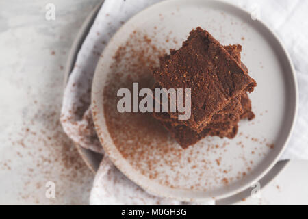 A stack of slices of healthy vegan brownies. Healthy dietary vegan dessert concept. - Stock Photo